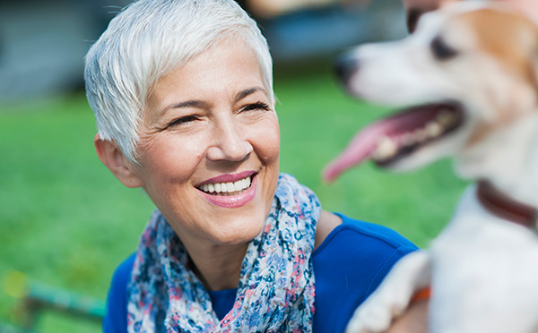 Woman smiling with dog